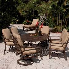 brown wicker outdoor furniture dresses: castelle coco isle cushion dining collection luxury patio furnishings with a resort style comfortable cushioned