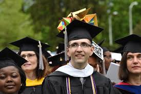 more than 800 mark graduation from college of science on drizzly tuesday morning 10 even as staff members were preparing for the largest ceremony during a full week of commencement activities at rowan