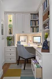 havent looked thru but maybe this would have an idea for fitting in a tiny office space in the mud room bonus mail and paperwork would find a landing chic home office features