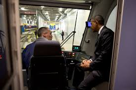 President Obama Lays Out New Plan for Upgrading Our Transportation    President Barack Obama sits in the cab and talks   a worker during a tour of