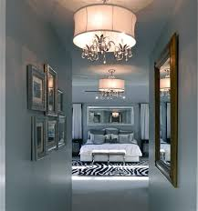 master bedroom lighting fixtures using candle light bulbs chandeliers above king size bed mattress also faux bedroom light fixtures