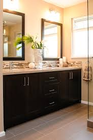 heres what the 12x24 gray tile would look like in a bathroom with darker cabinets bathroom furniture design