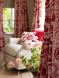 french country living room warm and casual lots of pattern color feminine casual living room lots
