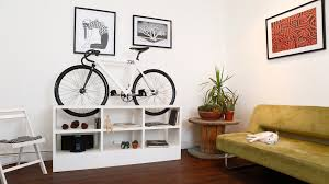 storage solutions living room: alluring home living  fascinating living room design with beige sofas and white painted wooden shelves under bicycle rack ideas as simple home bike storage solution cool birdhouse designs ideas cool indoor bike racks desig