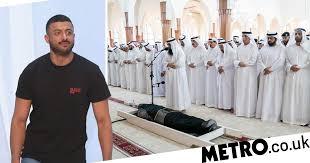Emir of Sharjah stands over Khalid Al <b>Qasimi's</b> body at funeral ...