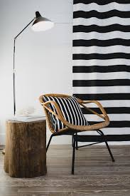 gallery outdoor living wall featuring:  living room chair with throw pillow featuring black and white striped sunbrella fabric and black and