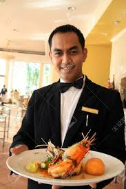 food server stock photos pictures royalty food server food server waiter holding prawn seafood stock photo