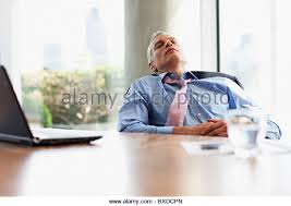 businessman napping at desk in office stock image business nap office relieve