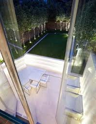 this is an amazing idea to create a high impact garden from a itty bitty plot of land contemporary city chic garden with sublime lighting interior amazing garden lighting flower