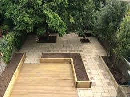 garden furniture patio uamp: patio designs with round fireplace also chic chairs plus square table