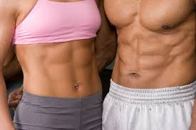 Woman and man with six pack abs