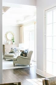 design ideas betty marketing paris themed living: sitting area with natural light and off white armchairs