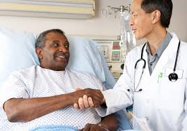 home com doctor ing senior male patient