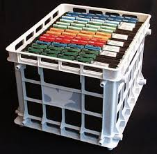 Whtie plastic crate with hangin file folers