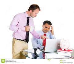 employee and his demanding boss stock photo image  businessman boss checking on his employee working hard on a project on computer and