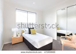 interior single bed window stock bedroom in a luxurious house has a single black color bed with white c