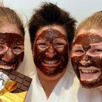 Lynette Johnstone (centre) and daughters Celine (left) and Jodie indulge in chocolate facials as part of the Dunedin Cadbury Chocolate Carnival, ... - lynette_johnstone_centre_and_daughters_celine_left_51f10f2567
