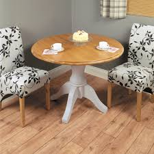 chadwick round dining table chadwick satin lacquered oak hidden