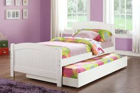 white wooden trundle beds for children with colorful bedding set and hardwood flooring plus purple wall bedroom kids bed set