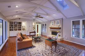 ceiling fans with lights for cathedral ceilings in living room with fireplace and white furniture best lighting for cathedral ceilings