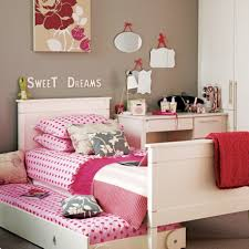 attractive tween girl bedroom with trundle bed and pink polka dot bed linen and sheet and bedroom furniture tween