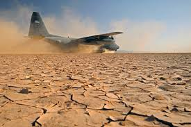 u s department of defense photo essay a u s air force c 130p aircraft lands on a dry lake bed during a