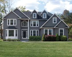 Huse Siding  Siding Replacement Project For Your Home - Black window frames for new modern exterior