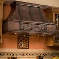 series vent hood:  the quot tuscan series copper range hood features a grape vine design this high quality kitchen exhaust is offered in two flue heights for a perfect fit