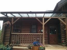 aluminium patio cover surrey: aluminium glass patio cover with wood maple ridge