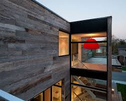 gallery outdoor living wall featuring: elegant modern new edinburg house in canada featuring exterior design with wooden wall facade and square living
