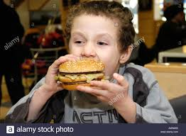 junk food and kids uk stock photos junk food and kids uk stock small boy eating mcdonald s big mac burger england uk stock image