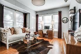 white daybed home office transitional with animal hide rug brown curtains gold table lamps gray walls animal hide rugs home office traditional