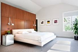 modern home kimberly demmy design inspiration for a large contemporary master bedroom remodel in los angeles wood panel walls bedroom wood wall panel