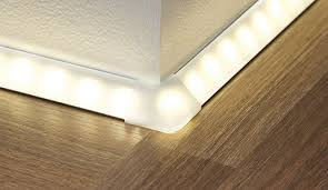 no wider than your thumb inconspicuously along the baseboard to give your floor a special touch the products sparkling row of lights seems to float baseboard lighting