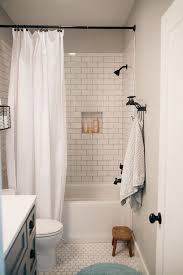 bathroom white tiles: white subway tile bathroom has both honeycomb and subway tiling from this image they dont seem to clutter one another as long as the bath mat and