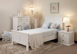 small platform bed with simple ornamentations and blue bedding set which looks calm white bedroom furniture bedroom furniture bedroom small