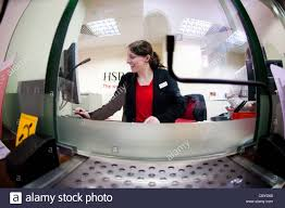 hsbc teller jobs photo hsbc teller jobs mba recommendation letter w bank teller working behind the counter at a branch of hsbc