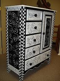 black and white painted bureau wonder if i could do this with the black armoire that holds my art supplies would look great in my studio black white furniture
