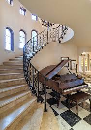 riverfront villa tuscan spiral staircase photo in miami automatic led stair lighting