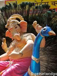 photo essay – the making of the ganpati idols   getsetandgoganpati   a peacock feather background