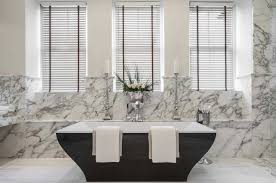 image bathtub decor: alone soaking tub and white with gray motives marble tiled wall panel also glass window using