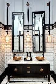 we are used to seeing mirrors over bathroom sinks and often in a foyer but here are 10 ideas for using mirrors in your home that might inspire you to think bathroom vanity milk glass tube pendant