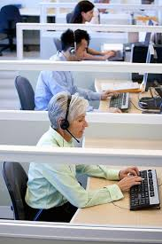 how to use a temp agency to a job mature female customer service representative wearing headset on the phone in a call center office