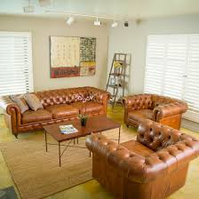 l simple interior design home living room ideas of pictures presenting brown top grain leather couch and double club chairs using button tufted rolled chic living room leather