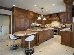 kitchen island centerpieces add traditional wood island matching cabinetry throughout this kitchen fea