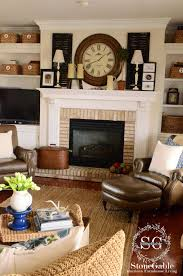 wall of black mantel ideas for brick fireplace outstanding living room design with cozy brown sofa plus fireplace brick desk wall clock