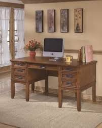 signature design by ashley cross island home office storage desk baybrin rustic brown home office small