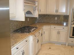 kitchen cabinets with granite countertops: modern kitchen design with st cecilia granite countertops amazing st cecilia granite design with white kitchen cabinet and bkack cooktop