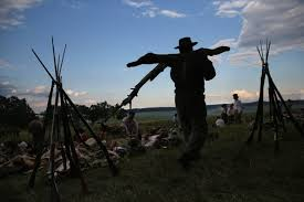 battle of gettysburg essay  Confederate Civil War re enactors gather wood to cook at sunset as part of a  Confederate Civil War re enactors gather wood to cook at sunset as part of a