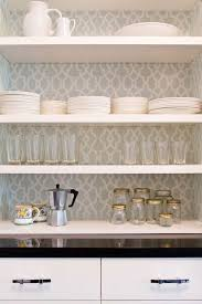 set cabinet full mini summer: elegant pantry features white floating shelves and cabinets painted in benjamin moore white dove with backs of shelves lined with schumacher summer palace